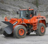 MAY XUC LAT DOOSAN - DL420A 1